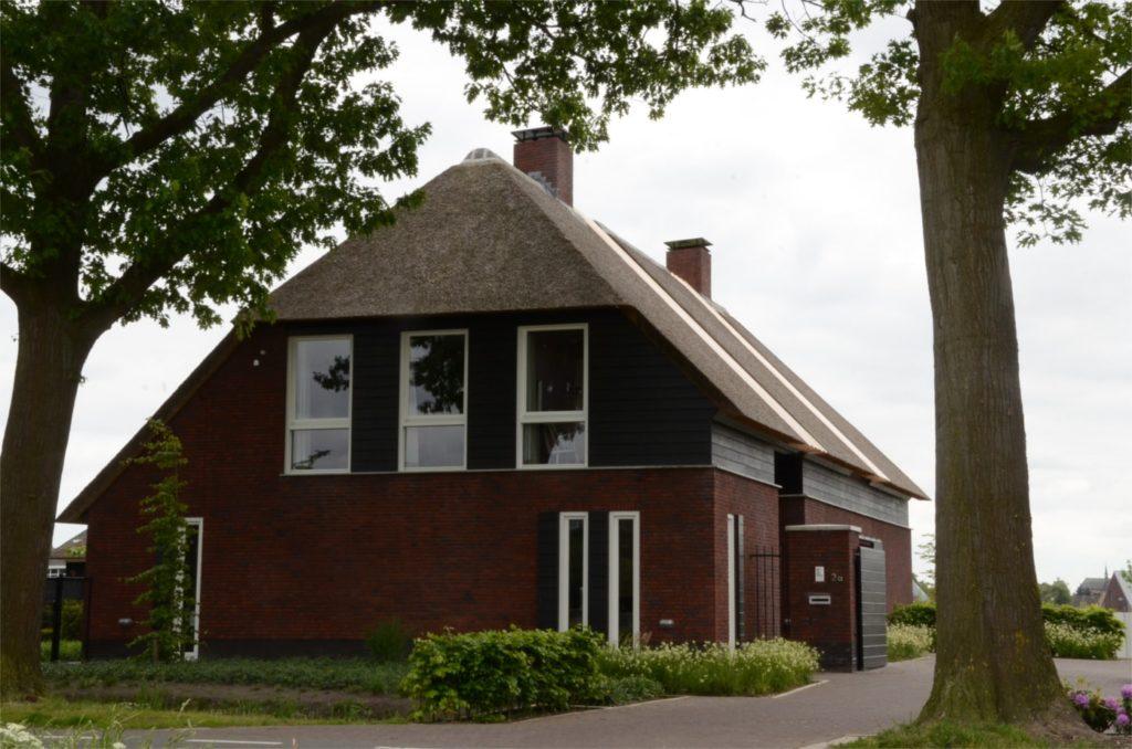 drijvers-oisterwijk-boerderij-riet-schoorsteen-houten-balken-wolfseind-baksteen