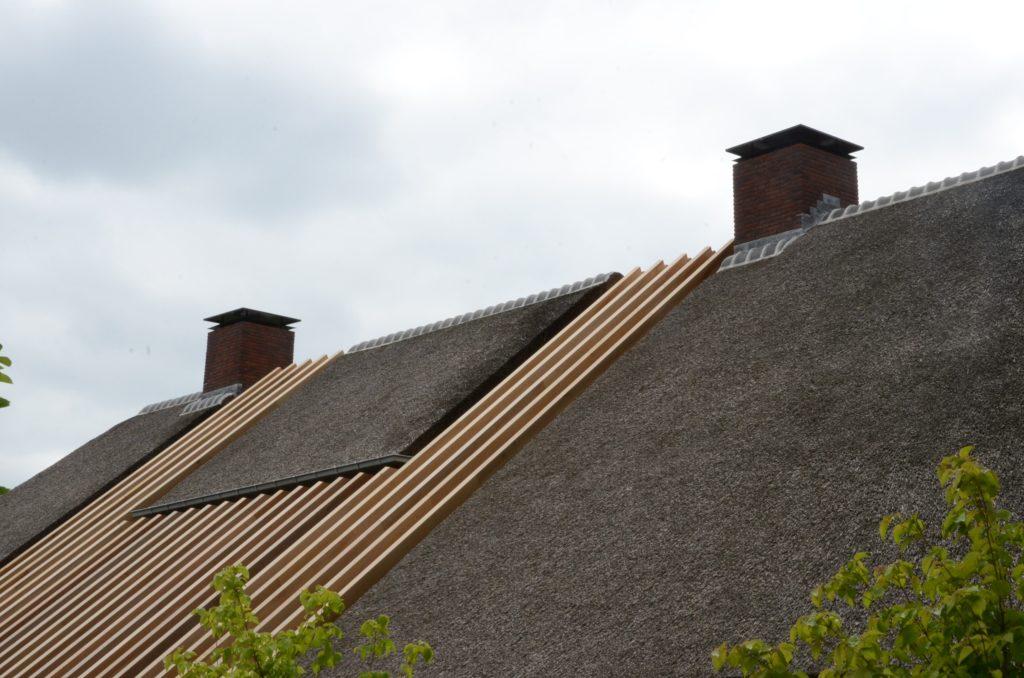 drijvers-oisterwijk-boerderij-riet-schoorsteen-houten-balken-wolfseind
