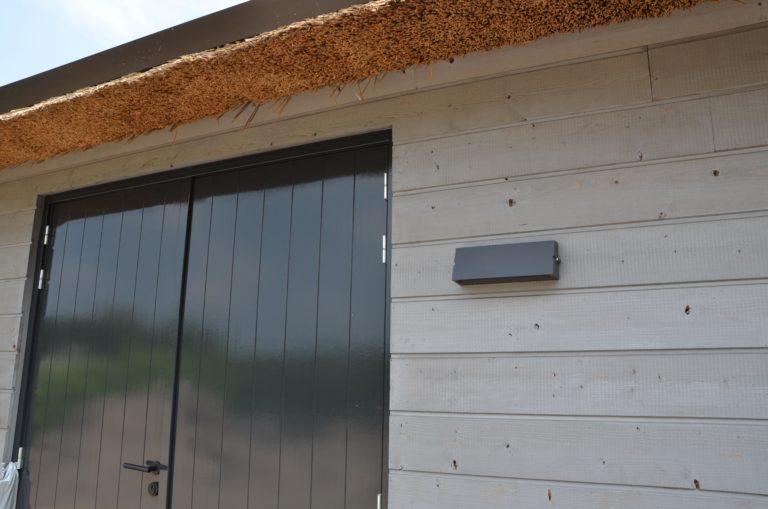 drijvers-oisterwijk-nieuwbouw-villa-riet-hout-bakstenen-verlichting-deur (34)