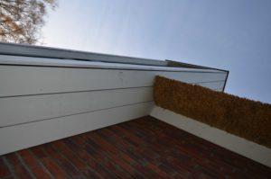 drijvers-oisterwijk-nieuwbouw-exterieur-riet-hout-bakstenen-gevel-grote-pui-ramen-dakkapel-hout-kozijn (4)