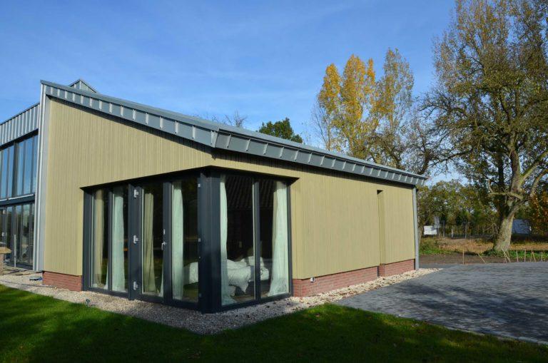 drijvers-oisterwijk-nieuwbouw-exterieur-zink-gevel-dak-strak-modern-bakstenen-deur-raam-pui (12)