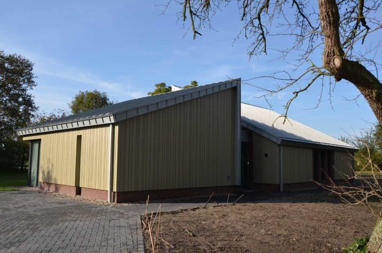 drijvers-oisterwijk-nieuwbouw-exterieur-zink-gevel-dak-strak-modern-bakstenen-deur-raam-pui (4)
