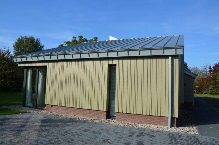 drijvers-oisterwijk-nieuwbouw-exterieur-zink-gevel-dak-strak-modern-bakstenen-deur-raam-pui (7)