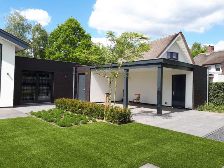 drijvers-oisterwijk-nieuwbouw-lessenaarsdak-dakpannen-wit-stucwerk-modern-strak-exterieur-bakstenen-ramen-grote-pui (12)